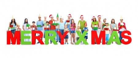Business people holding letter 'MERRY X'MAS'