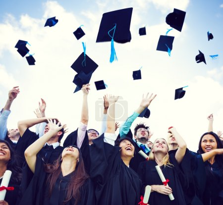 Photo for Graduation Caps Thrown in the Air - Royalty Free Image
