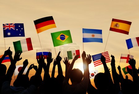 People Holding Flags of Various Countries