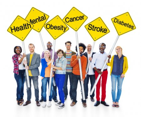 People Holding Health Related Words