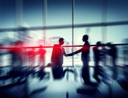 Two Businessmen Handshaking