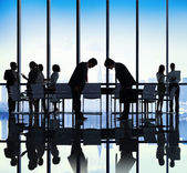 Business People Bowing Down in Office