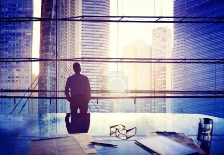Businessman Thinking in office building