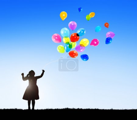 Silhouette of a Little Girl with Balloons and Copy Space