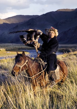 Kazakh men hunt foxes and wolves
