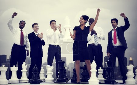 Business People Winning Chess Game
