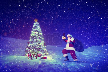 Santa Claus near Christmas tree