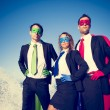 Постер, плакат: Business superheroes facing storm