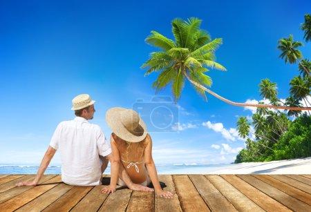 Couple on Wooden Floor at Beach