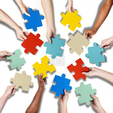 Hands Holding Jigssaw Puzzle