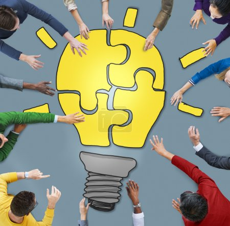 People with Light Bulb Jigsaw Symbol