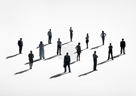 Silhouettes of business people standing