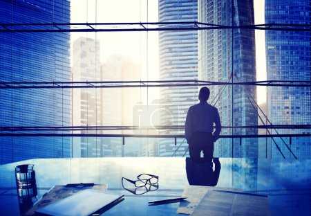 City Scape and Businessman Thinking