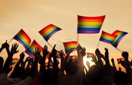 People Holding Gay Pride Symbols