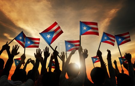 People Waving Flags of Puerto Rico