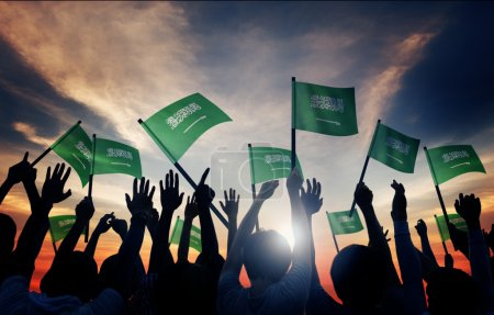 People Holding Flags of Saudi Arabia