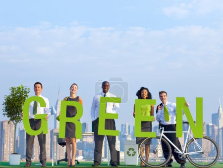 Business People holding word Green