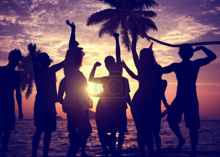 People celebrate at a party on a tropical island
