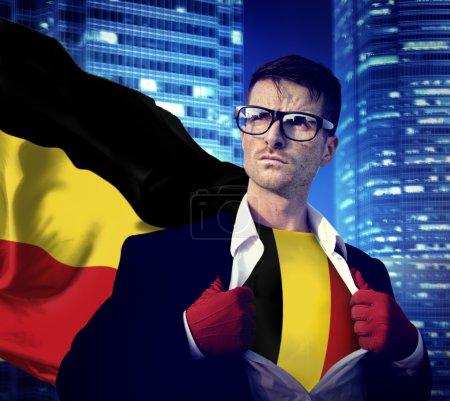 Businessman Superhero with Belgium Flag Concept