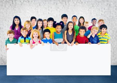 Group of Multiethnic Children with blackboard