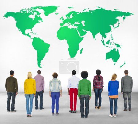Group of multi ethnic people with world map