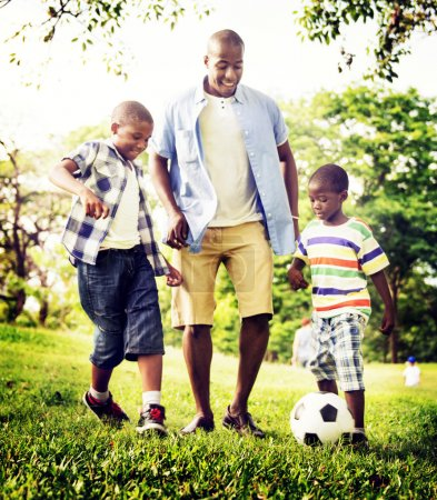 Happy African Family playing with a ball