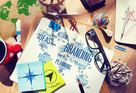 Messy office desk with Branding Concept