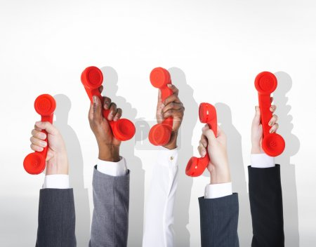 Business people with Red handsets