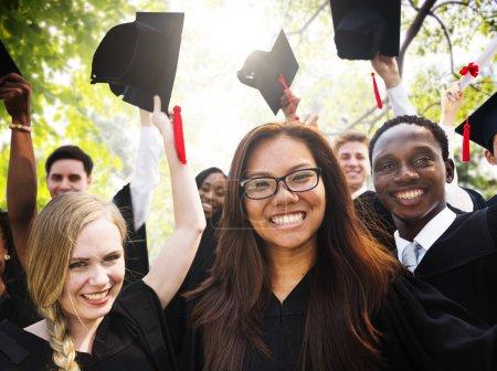 Diversity Students Celebrating Graduation Concept