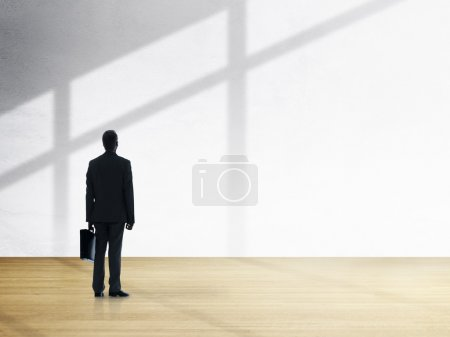 Businessman Standing and Looking
