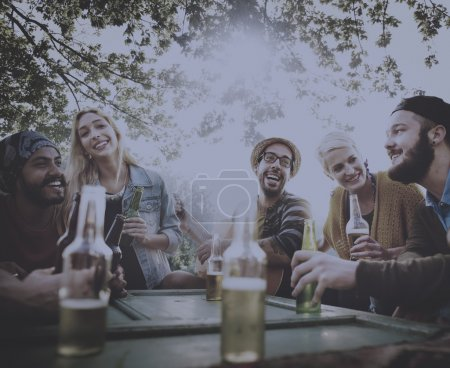 friends hanging out at outdoors party