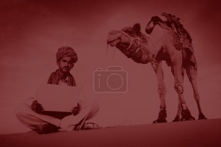 Photo for Indian Man Using Laptop in Desert Concept - Royalty Free Image