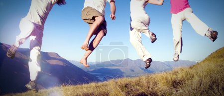 Group of young people jumping Concept