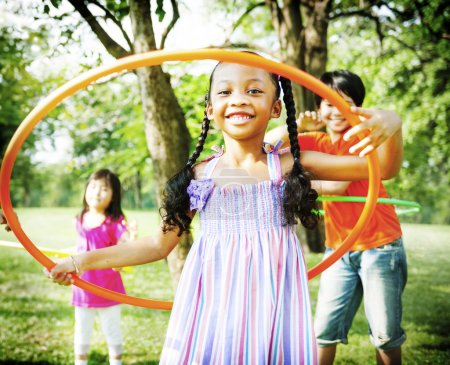 Children Playing with Hoop Concept