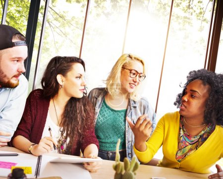 Diverse college students brainstorming in classroom
