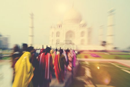 People Walking Through the Taj Mahal