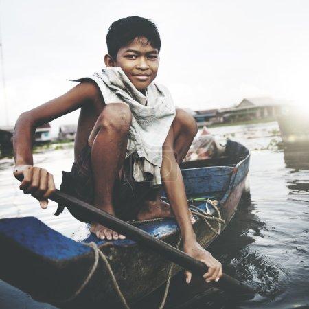 Boy Traveling by Boat