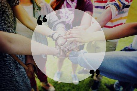 friends making unity gesture