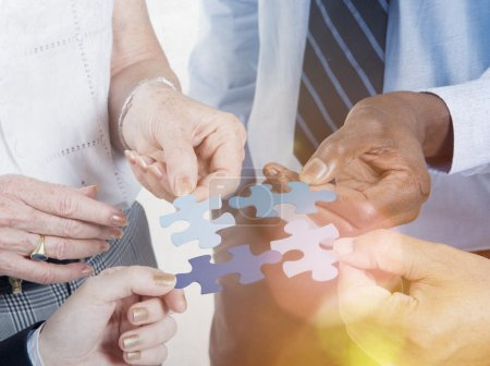 Business Connection Corporate Team with Jigsaw Puzzle Concept