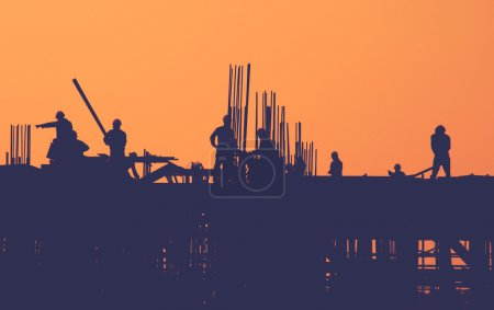Construction Workers at Building cite