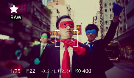 Businessmen in superhero masks