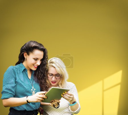 female students using tablet pc