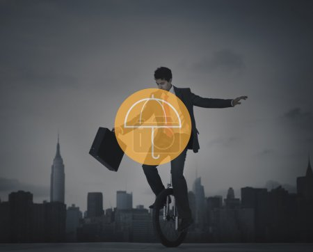 businessman riding one wheel bicycle
