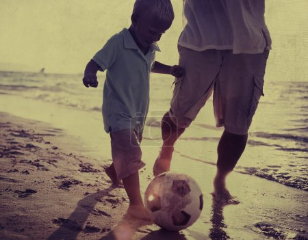 Father and Son Playing Soccer Concept