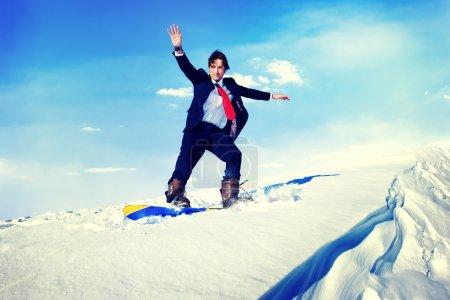 Businessman Snowboarding Mountain