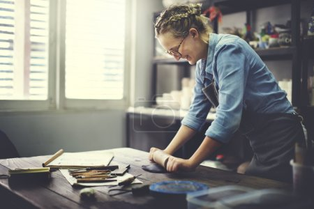 Woman Rolling Clay Concept