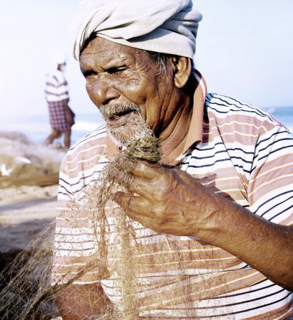 Fisherman holding net