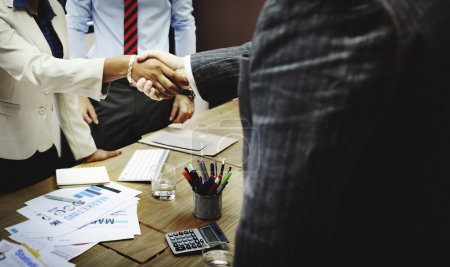 Business people handshaking to confirm deal