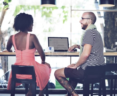 man and woman working with laptop
