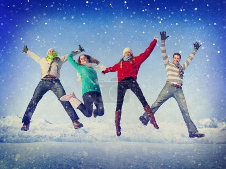 Friends jumping in snow